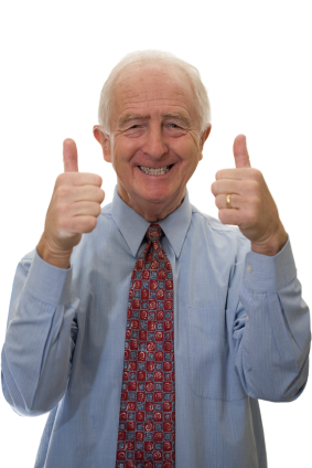A smiling businessman holding his thumbs up.