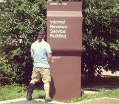 Urinating on IRS sign
